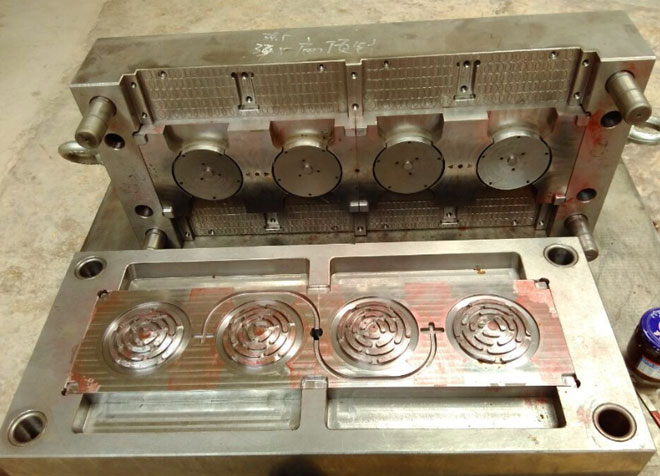 Injection mold for coaster lid